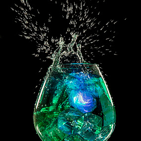 Glow drink by Amelia Falk - Food & Drink Alcohol & Drinks ( spectacular, stream, surface, splash, colorful, drop, shatter, yellow, glow, frozen, breakage, droplets, drink, glass, money, light, wine, water, spirits, fruit, trickle, green, bubbles, suspended, edible, amazing, color, blue, food, alcohol, explosion, slice, tension )