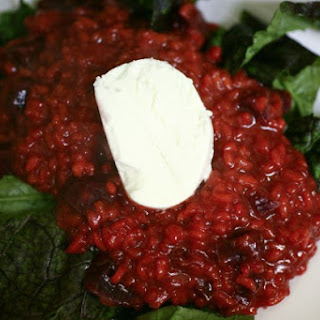 Red Beet Risotto with Mustard Greens and Goat Cheese.