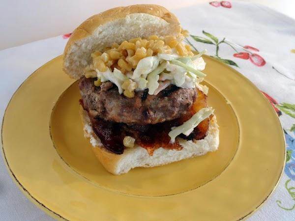 Make burger by adding bacon to the bottom bun, a burger, slaw and charred...