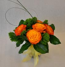 Photo: Orange Roses $30.00 each.