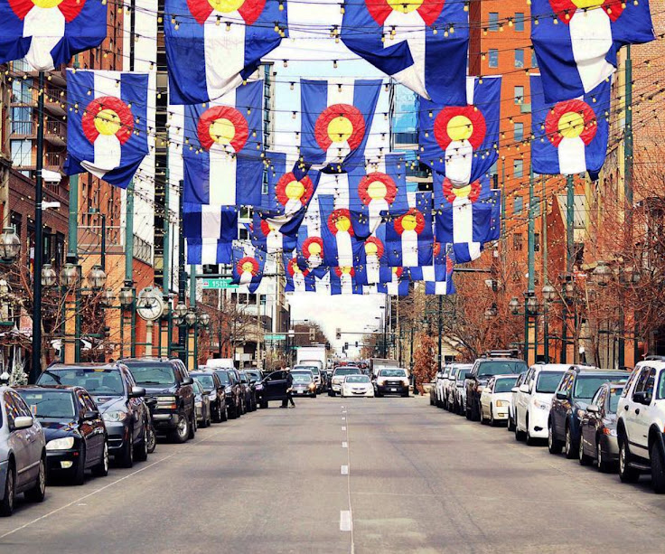 The flags and lights hanging above Larimer Street.