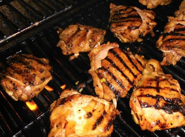 heat grill to medium heat. spray grill grates with pam.  place chicken skin...