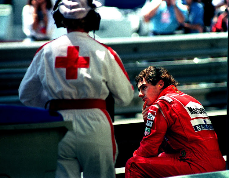 FILE PHOTO: ON THIS DAY -- May 22 FORMULA ONE - Ayrton Senna of Brazil is approached by a medic as he sits on the guard rail after crashing in the final practice session of the Monaco Grand Prix in this May 22 1993 file photo. Picture: REUTERS/MAL LANGSDON