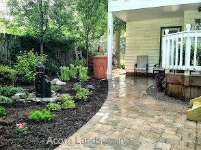 Photo: Acorn Ponds & Waterfalls, Certified Aquascape Contractor of Rochester NY Installs Aquascape Rain Barrel to re-use stored Rain Water in the Gardens and help with Drainage issues for this Penfield NY Home.  Check out our website www.acornponds.com and give us a call 585.442.6373.  To learn more and #LandscapeIdeas please click here: www.acornponds.com/landscape-design.html  For More info about Geoff and Karen's amazingproject please visit: www.facebook.com/notes/acorn-landscaping-landscape-designlightingbackyard-water-gardens/landscape-design-installation-walkway-patio-rock-fountain-waterfall-in-penfield-/238744206162709  Sign up for your personal design consultation here: www.acornponds.com/contact-us.html  Acorn Ponds & Waterfalls of Rochester NY, 585-442-6373, is a Certified Aquascape Contractor, Landscape Designer, Outdoor Lighting Designer, Installer, Builder, Contractor and Design Service Company from Rochester, NY. We have professional Installation and Design Services available for the following: Landscape Design Outdoor Room Design Backyard Ponds and Waterfalls Design & Construction Patios and Walkways: Paver, Stone, Brick Low Voltage Landscape Lighting LED Landscape Lighting Swimming Ponds Ecosystem Ponds LED Outdoor Lighting Retaining Walls Fountains Water Features Pondless Waterfalls Pond Maintenance and Design Aquatic and Under Water LED Lights Bubbling Boulders and Urns Natural Stone Patios and Rock Gardens Garden Ponds Outdoor Kitchens Pizza Ovens Fire Pits Fish or Koi Ponds Waterfall Ponds Low Maintenance Plantings Commercial Landscape Design Residencial Landscape Design Drainage Issues, Solutions Aquascape Rainwater Collection Systems  We serve Pittsford NY, Penfield NY, Brighton NY, Fairport NY, Webster NY, Greece NY, Victor NY, Henrietta NY, Irondequoit NY, Rush NY  Click here for a free Magazine all about Ponds and Water Features: http://flip.it/gsrNN  Find us on Houzz here: www.houzz.com/pro/acornlandscapedesign/acorn-landscaping-and-ponds-l