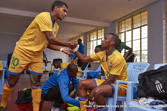 Photo: Quentin Rushenguziminega (10) bonds with team mates prior to kick off.  [Rwanda Vs Ghana AFCON2017 Qualifier, 5 Sep 2015 in Kigali, Rwanda.  Photo © Darren McKinstry 2015]