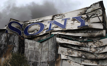 Photo: Smoke billows from the Sony Centre in Enfield, north London August 9, 2011.  British Prime Minister David Cameron said he would recall parliament from its summer recess for a day on Thursday after rioting swept through London for three consecutive nights.  REUTERS/Chris Helgren   (BRITAIN - Tags: CIVIL UNREST CRIME LAW POLITICS SOCIETY)