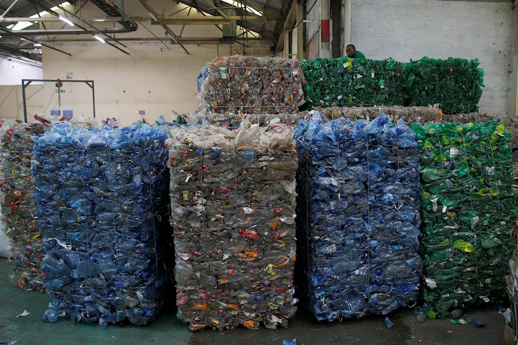 Used plastic bottles are seen staked before being processed at the Mr. Green plastic recycling factory in Nairobi