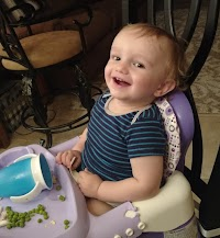 Jonathan smiling in his high chair