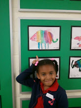 Photo: Kaleya shows off her art at on the school wall - March 2, 2011