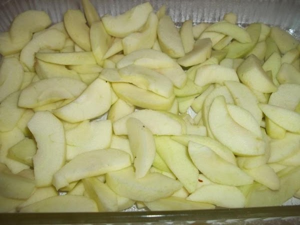 Grease a 9 x 13 baking dish.  Preheat oven to 375 Degree F.  Spread sliced apples...
