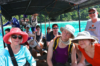 Photo: Our group transferred from the speedboat to a longtail boat to take us onto North Surin island.