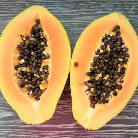 The two halfs of papaya by Svetlana Saenkova - Food & Drink Fruits & Vegetables ( papaya, black and yellow,  )