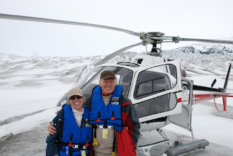 Photo: Jeannene and Ken; helicopter parked on glacier along Taku River