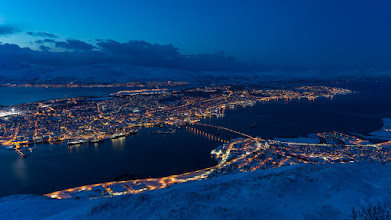 Photo: Tromsøya island, with the city of Tromsø, in the winter evening.