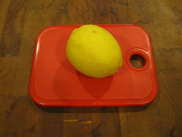Simple..place a washed lemon in the freezer section of your refrigerator. I placed it...