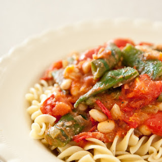 Fresh Beans And Tomatoes Over Pasta.