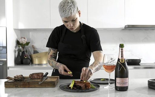 Chef Ash Heeger plates a dish of the delicious food at the Moët & Chandon pairing in Cape Town.