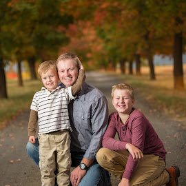 Father and sons by Craig Lybbert - People Family ( maple trees, tree lane, son, fall colors, sons, father, father and sons,  )