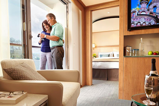 Viking-Longship-Veranda-Stateroom.jpg - A Veranda Stateroom on your Viking Longship features hotel-style beds, a private bathroom, roomy closets and storage space, and amenities like flat-panel TVs and premium bath products.