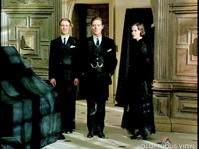 Kate Beckinsale, Anthony Andrews, and Alex Lowe dressed in black in the film Haunted.