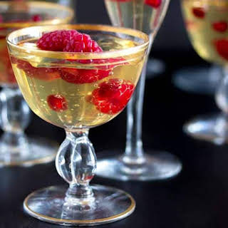 CHAMPAGNE GELÉE WITH RASPBERRIES & POMEGRANATE.