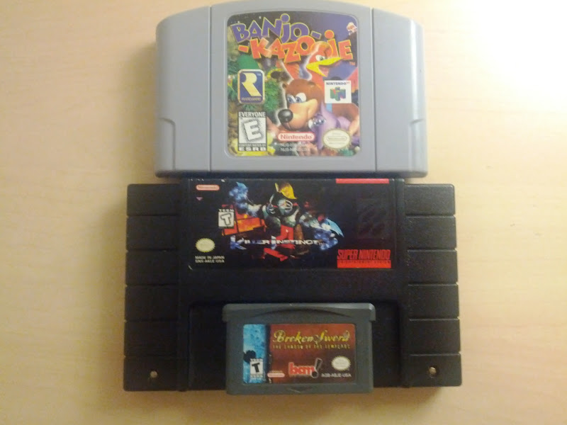 Photo: Banjo-Kazooie for the N64, Killer Instinct for the SNES< and Broken Sword: The Shadow of the Templar for GBA. Thanks Mom and dad!