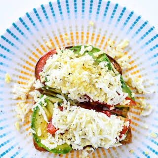 Avocado Toast with Tomato and Hard Boiled Egg.
