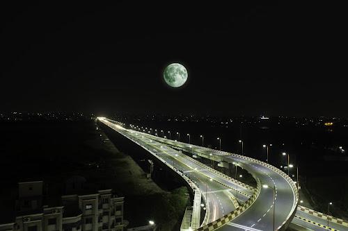 Surat Jilani Bridge by Himanshu Jethva - Buildings & Architecture Bridges & Suspended Structures ( moon, surat, astrophotography, full moon, night, india, bridge, astronomy )
