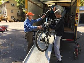Photo: Gene Carlough and Henry Arnold hand bike to Ev Pinneo