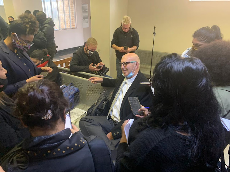 Journalists surround attorney Eric Bryer in the Bishop Lavis magistrate's court on September 25 2020. Bryer represents Zane Kilian, who appeared in connection with the murder of Lt-Col Charl Kinnear.