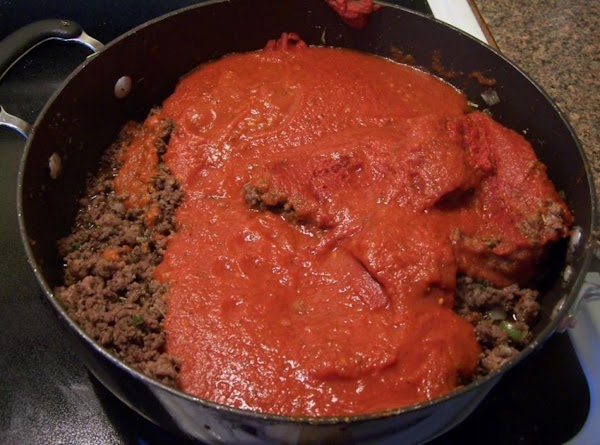 Add in tomato paste and pasta sauce.  Let simmer 10 to 15 minutes.