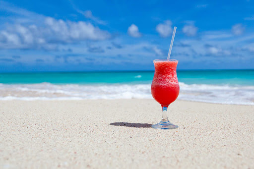 beach-cocktail.jpg - Beach + tropical cocktail = the perfect way to unwind.