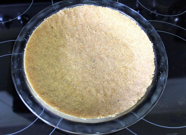 Graham cracker crust pressed into clear pie pan.
