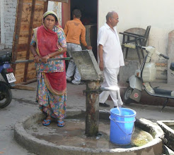 Photo: The Public Street Well  Water the life breath of any food from the fields to the table. These wells and pumps are locating systematically throughout cities so that a short walk from your home you can get drinking water. Its seems to be the females job since I have yet to see a man sarrying water on his head.