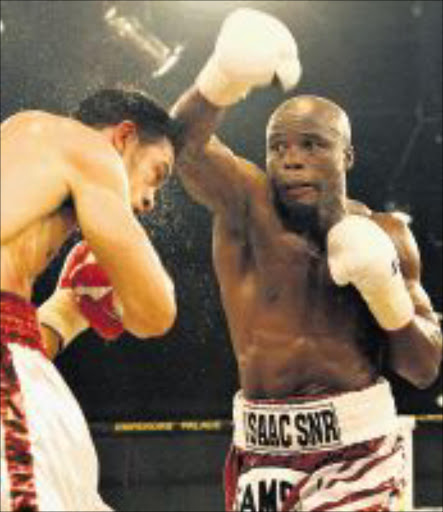 take that: South Africa's Isaac Hlatshwayo punches Delvin Rodriguez of the US in their IBF Welterweight Eliminator fight which Hlatshwayo won on a split decision at Emperor's Palace in Ekurhuleni. Pic: SYDNEY SESHIBEDI. 17/11/2009. © Sunday Times.