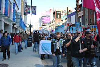 Photo: As the march and rally proceeded through the downtown core, demonstrators emplored people on the sidewalk to join them. Some of them did, while, unfortunately, others still have no idea what the demonstration was about.
