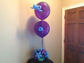 Photo: Purple & blue ballowers w/ donuts and curly q's