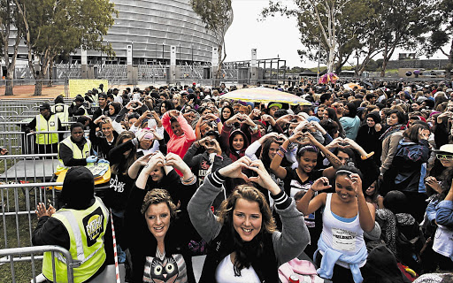 Fans of Canadian pop singer Justin Bieber, or 'Beliebers', at the Cape Town Stadium, yesterday. Many of his fans waited outside the stadium for a whole day or more. Bieber went on stage just before 9pm and got straight into 'All Around The World', followed by 'Take You' and 'Catching Feelings'. He also performed crowd favourites such as 'Never Say Never', 'Beauty and a Beat' and 'Baby'