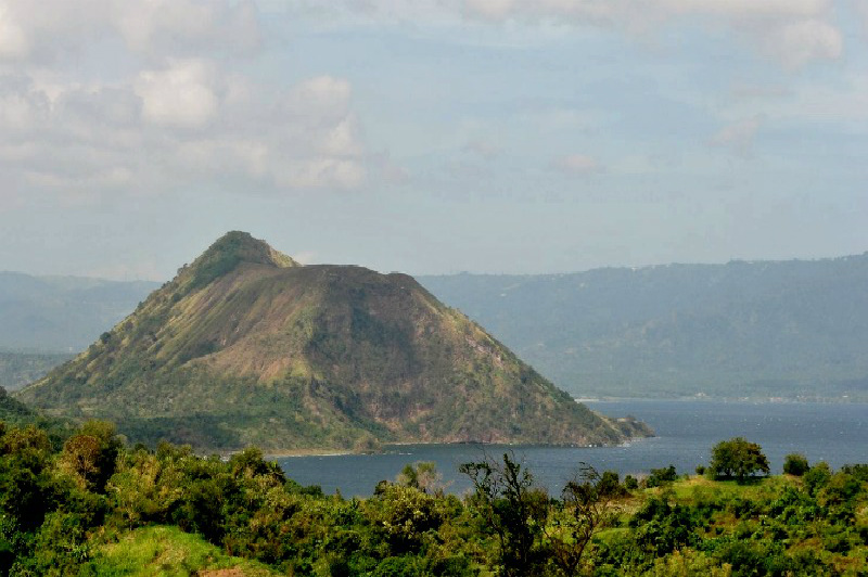Photo: Philippines Taal Volcano, the world's smallest volcano is located on a serene blue lake in this city. With cool climate and clean air, this city is also the perfect place for leisure activities like picnics, horseback riding, camping, etc. Can you name this city?