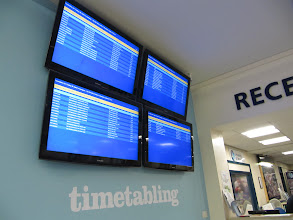 Photo: Forget where or when your class is meeting? Just look it up on one of the monitors in the reception area