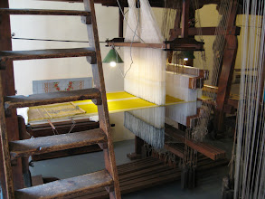 Photo: A silk weavers shop.  Silk was important domestically and the Jacquard loom was invented here.  Our new Chinese friends told us they raised silkworms when they were girls.  I wonder if young Frenchwomen tell the same story?