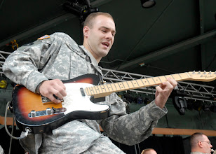 Photo: Spc. Jonathan Krentz played the guitar during the 34th Red Bull Infantry Division Band's performance at the Minnesota State Fair's Military Appreciation Day Aug. 30, 2011 in St. Paul, Minn.