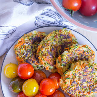 Vegan Zucchini Carrot Fritters with Pan-Roasted Cherry Tomatoes.