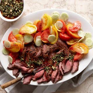 Flank Steak with Chimichurri, Tomatoes, and Cucumbers.