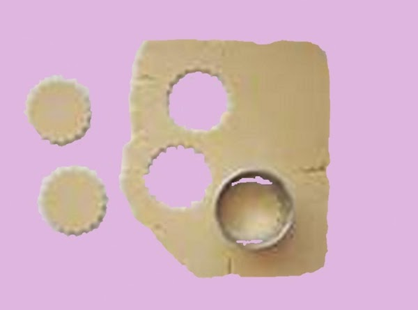 Roll out the dough to 1/4 inch thick on a lightly floured surface. Either...