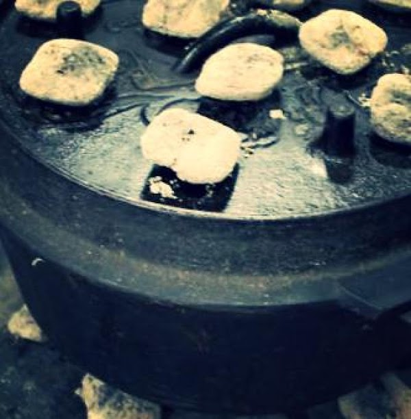 Set the Dutch oven on 8 to 10 coals.  Put 10 to 15...