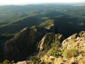 Photo: View from Hermits Peak at dawn. Looking southeast over the rolling forested foothills to the grassy Great Plains in the distance.
