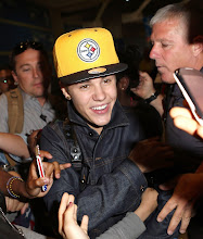 Photo: Singer Justin Bieber is mobbed by fans upon his arrival in Paris, France on May 31, 2012. After posing for a picture with the Biebs, a female fan touches his face and Justin's security team quickly pushes her away. Fortunately for the fan, Justin didn't unleash his fists of fury on her- since, as we've seen recently, one punch from the Biebs could land you in the hospital... RESTRICTIONS APPLY: USA/AUSTRALIA ONLY