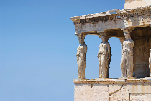 See the massive female statues called the Porch of the Caryatids at Erechtheion temple at the Acropolis in Athens, Greece.