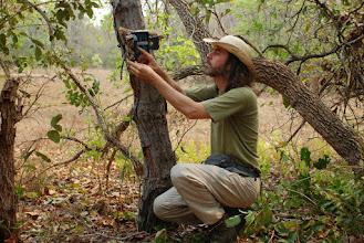 Photo: Checking a camera trap